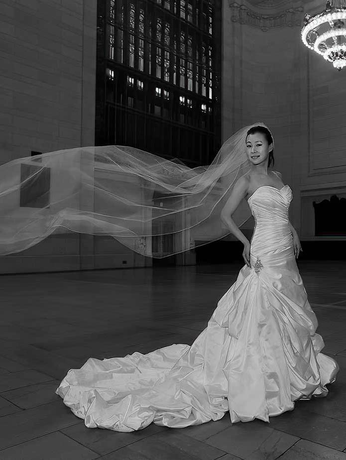 Photograph of wedding veil flowing in the wind